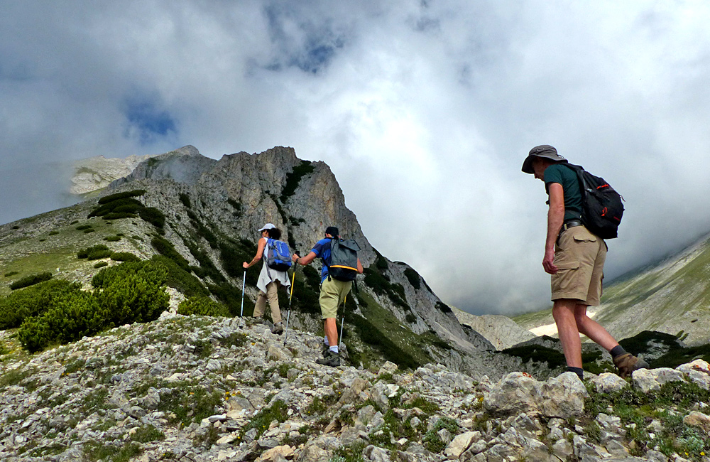 climbing up the vihren summit in pirin mountains, bulgaria