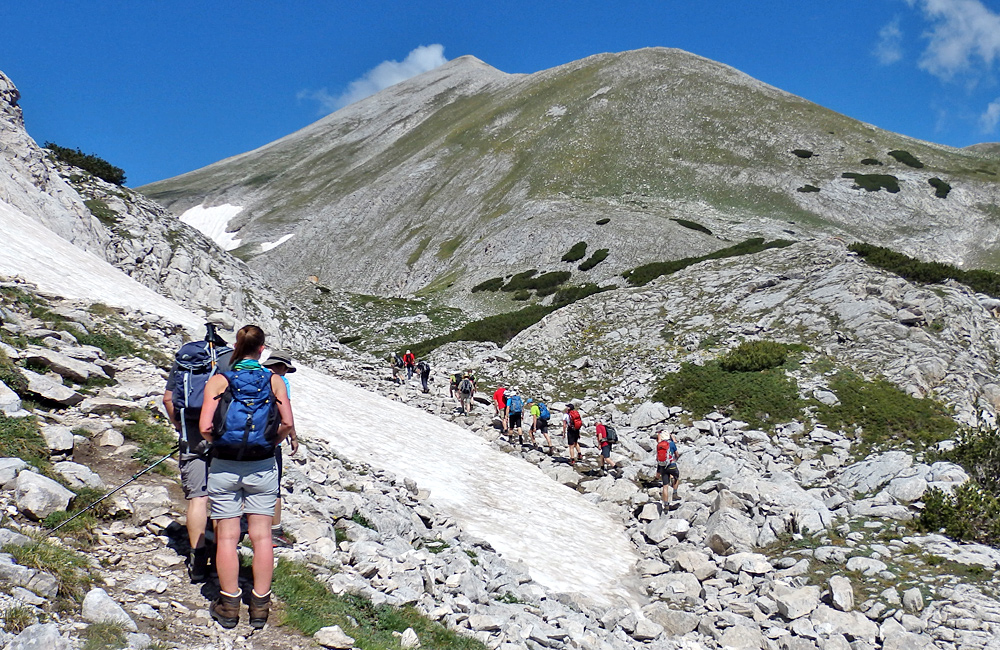 summiting mount vihren in pirin mountains, bulgaria